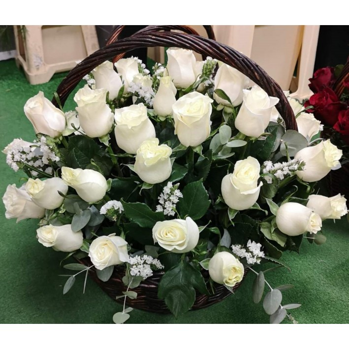 40 white roses in a basket