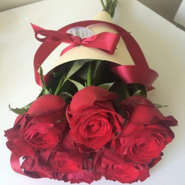 11 red roses in a bag