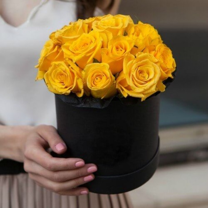 15 yellow roses in a black box